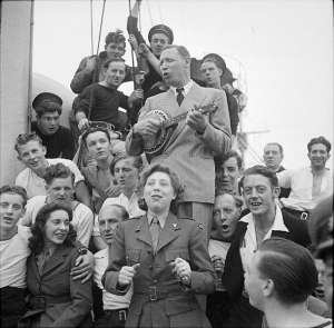 George Formby entertaining sailors on HMS Ambitious