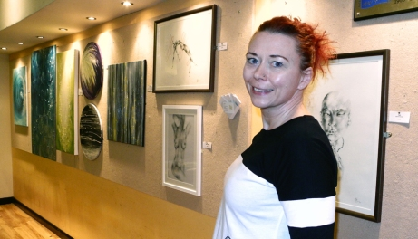 Zoe Clemence with her work at the Queen's Theatre, Bar Exhibition area. The display will run until February 24, 2015